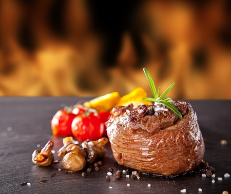 nicely decorated steak on wooden table photo