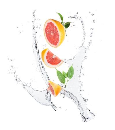 Grapefruit in splashes Фото со стока