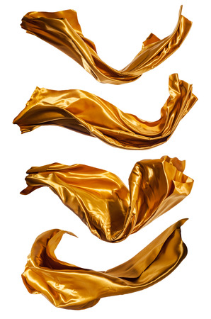 flowing: Isolated shots of freeze motion of gold satins, isolated on white background