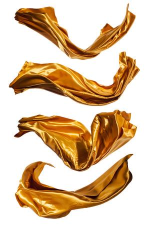 Isolierte Aufnahmen von gefrier Bewegung von Gold Satin, isoliert auf weißem Hintergrund