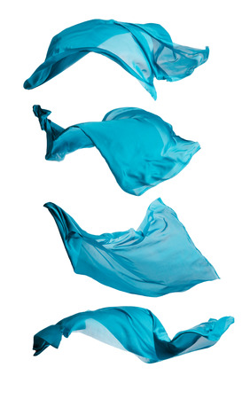 Isolated shots of freeze motion of transparent blue silks, isolated on white background
