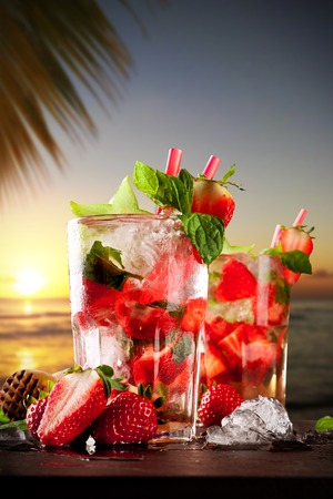 Mojito drinks on stone with evening blur ocean shore background photo