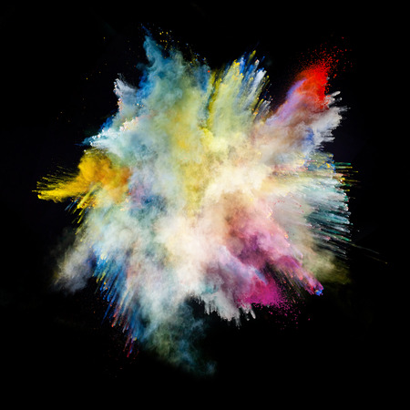 Colored dust on black background Stock Photo