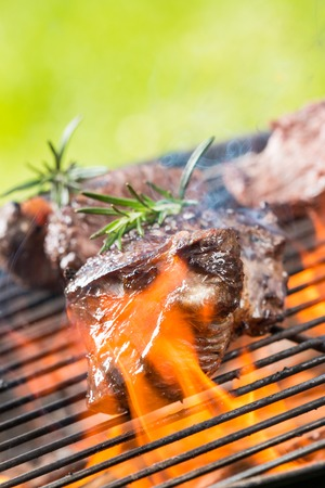 coals: Delicious grilled beef steaks burning on fire