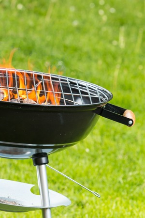embers: Empty grill on garden with burning embers Stock Photo