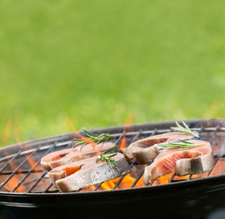 staycation: Delicious grilled salmon steaks on fire Stock Photo