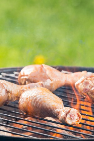 raw chicken: Chicken legs on barbecue grill with fire