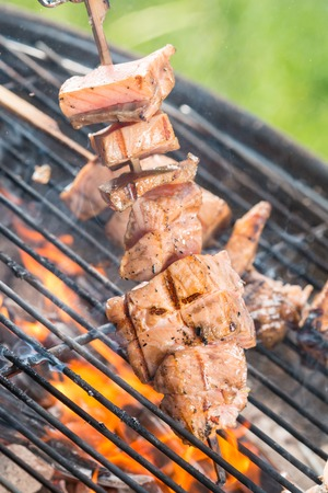 staycation: Delicious grilled salmon skewers on fire Stock Photo