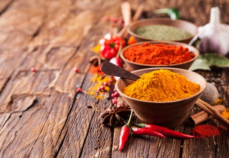 indian spices: Various kinds of spices on wooden planks Stock Photo