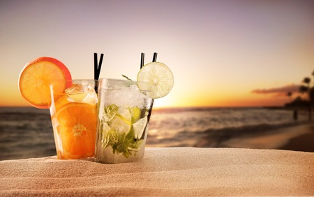 Exotic summer drinks , blur sandy beach on
