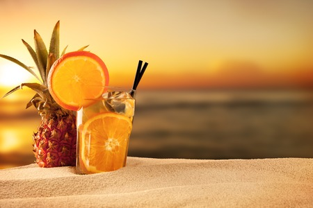 Exotic summer drink with sea shells,