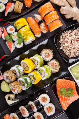Various kinds of sushi food served on black stone photo