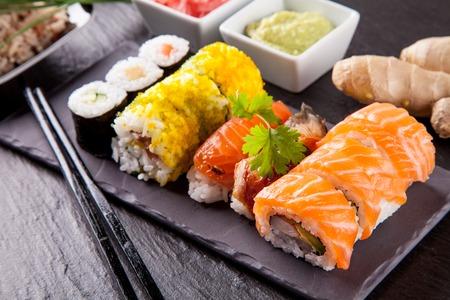 sushi menu: Various kinds of sushi food served on black stone