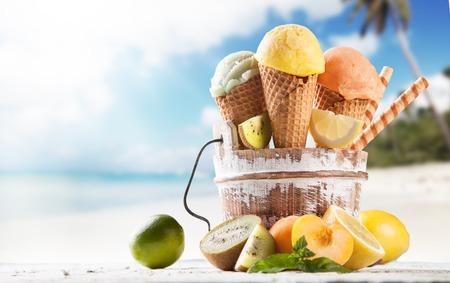 cream and green: Fresh fruit ice cream scoops in cones