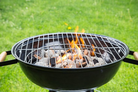 Empty grill on garden with burning embers Stock Photo
