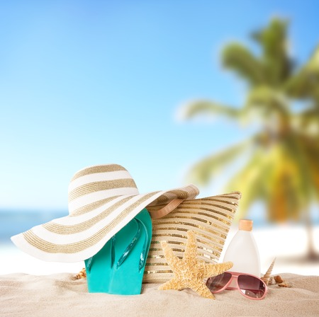 sun hat: Summer concept with accessories on sandy beach