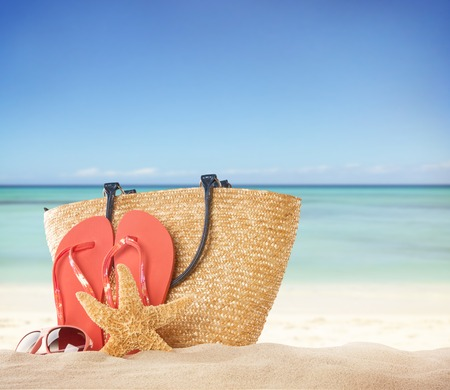 Summer concept with accessories on sandy beach