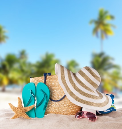 Summer concept with accessories on sandy beach photo