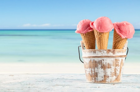 Fruit ice cream with blur beach as background  Served on wooden planks