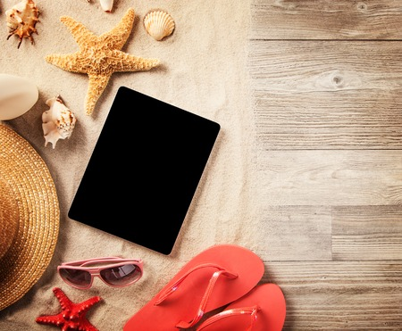 holiday display: Top view of summer accessories and blank tablet on wooden planks