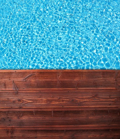 pool deck: Empty wooden mole with swimming pool, shot from top view