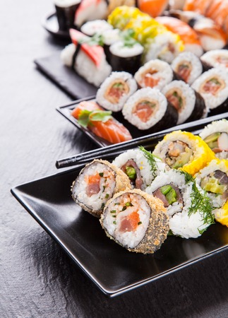 black stone: Various kinds of sushi food served on black stone