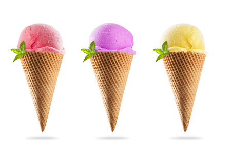 Set of various kinds of ice creams in cones, isolated on white background photo