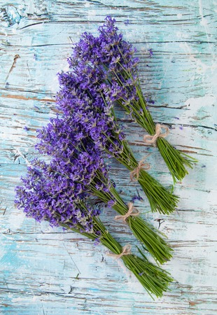 Lavender blossoms on wood photo