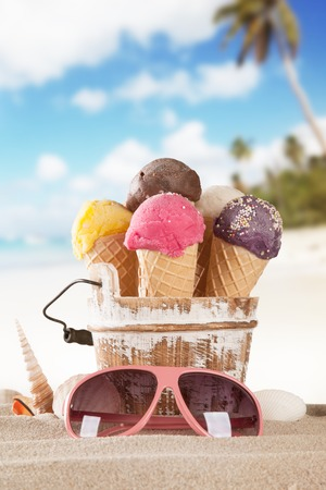 Set of various kind of fruit ice cream on wooden deck with blur sea on background Imagens - 29581709