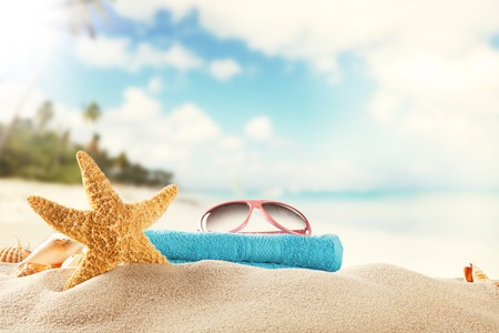 Sandy summer beach with blur sea on background