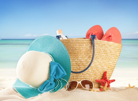Summer concept with swimming accessories and blur sea on background photo