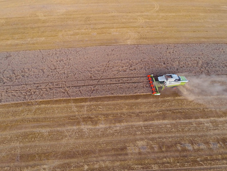 harvester: Top view of harvesting combiner on field