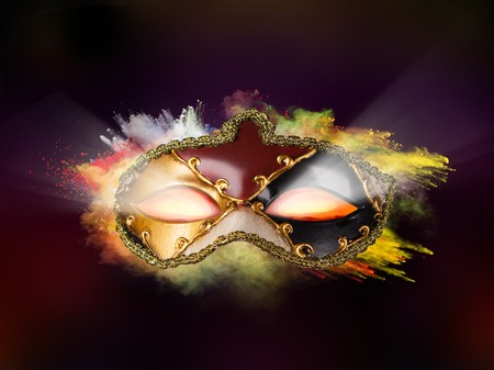 Isolated Venice mask with freeze motion of colored powder on black background photo