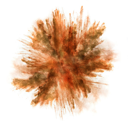Freeze motion of orange dust explosion isolated on white background Imagens