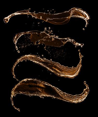 Golden splashes collection, isolated on black background photo