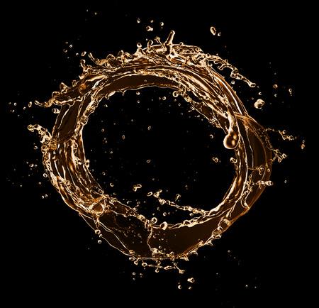 Golden splashes circle, isolated on black background photo