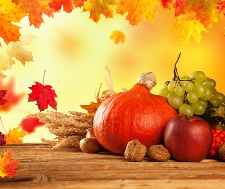Autumn concept of traditional food  Mix of pumpkins, fruit and vegetable on wooden table with blur background  Free space for text photo