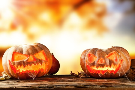 wood spider: Concept of halloween pumpkins on wooden planks with blur background  Stock Photo