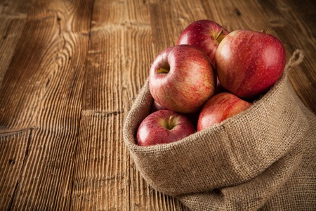 Autumn fruit on wooden planks photo