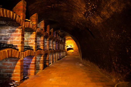 Long exposure of wine cellar with many bottles photo
