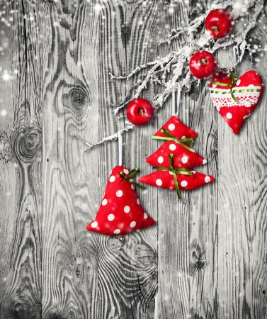 x country: Home made traditional decoration on branch. Wooden planks as background Stock Photo