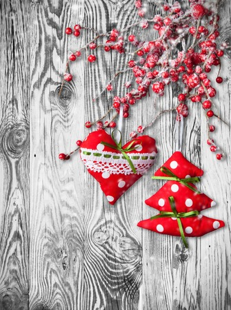 Home made traditional decoration on branch. Wooden planks as background photo