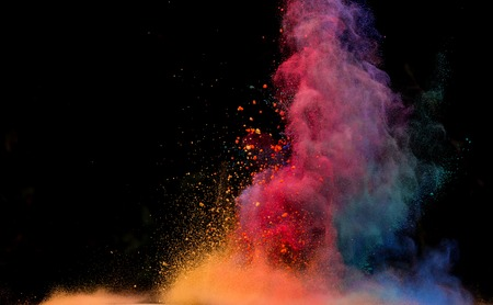 Freeze motion of colored dust explosion isolated on black background Stock Photo