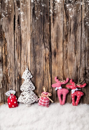 traditional christmas: Home made traditional cloth decoration on wooden planks