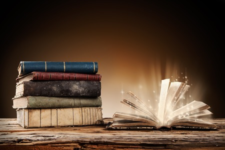 text books: Old books on wooden planks with blur shimmer background