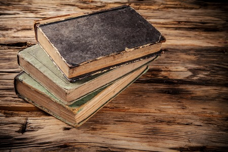 cultural history: Pile of old books on wooden planks Stock Photo