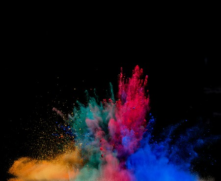 Freeze motion of colored dust explosion isolated on black background Imagens