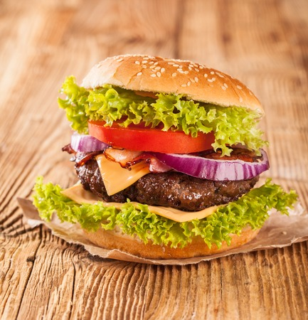 ground beef: tasty beef burgers on wooden table Stock Photo