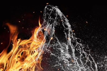 Symbol of water and fire energy, isolated on black background photo