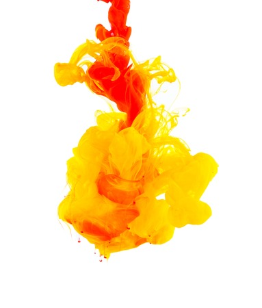 Studio shot of colored ink in water, isolated on white background Banco de Imagens